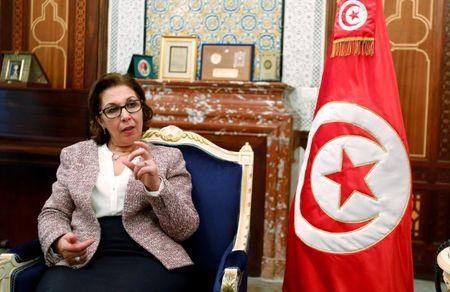 Tunisia's Finance Minister Lamia Zribi gestures as she speaks during an interview in Tunis
