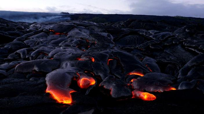 <p>A stream of hot lava makes its way down the Kilauea Volcano in Hawaii Volcanoes National Park. // September 2016</p>