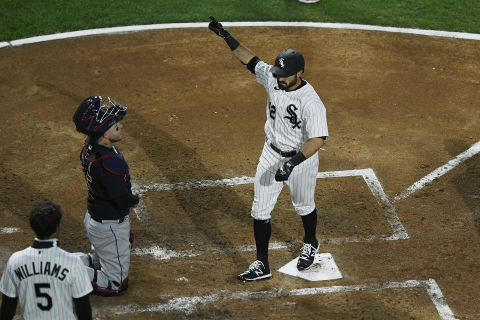 Chicago White Sox's Adam Eaton (12) celebrates at home plate after hitting a three-run home run during the third inning of a baseball game against the Cleveland Indians Monday, April 12, 2021, in Chicago. (AP Photo/Paul Beaty)