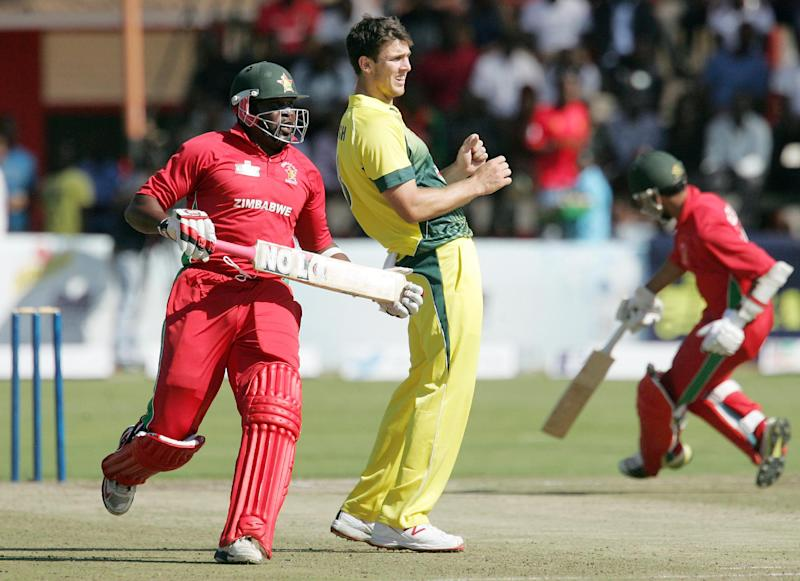 Zimbabwe's batsman Hamilton Masakadza (L) runs between the wickets past Australia's Mitchell Marsh during the opening cricket match between Australia and Zimbabwe as part of a one-day triangular series at the Harare Sports Club on August 25, 2014