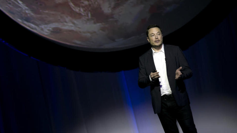 SpaceX founder Elon Musk speaks during the 67th International Astronautical Congress in Guadalajara, Mexico, Tuesday, Sept. 27, 2016. In a receptive audience full of space buffs, Musk said he envisions 1,000 passenger ships flying en masse to Mars, 'Battlestar Galactica' style. He calls it the Mars Colonial fleet, and he says it could become reality within a century. Musk's goal is to establish a full-fledged city on Mars and thereby make humans a multi-planetary species.