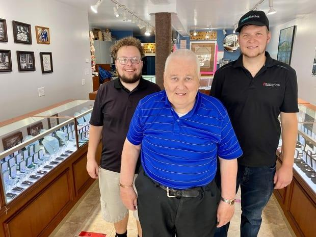 Grant Moase, centre, is closing down the family run Moase Quality Jewellers after 80 years. His two sons Gregory, left, and Matthew have worked at the store for years. (Jane Robertson/CBC - image credit)