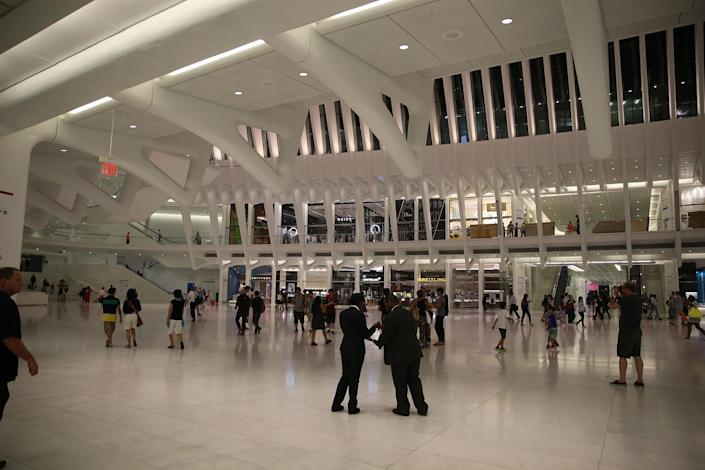 <p>People walk through the Oculus mall at World Trade Center on Wednesday, August 17, 2016. While mostly below street level, light beams in through the windows of the winged Oculus, designed by Santiago Calatrava, that top the transportation hub of 13 subway trains and river ferries. More than 300,000 commuters use it on a daily basis, many for jobs beyond finance in advertising and media. (Gordon Donovan/Yahoo News) </p>