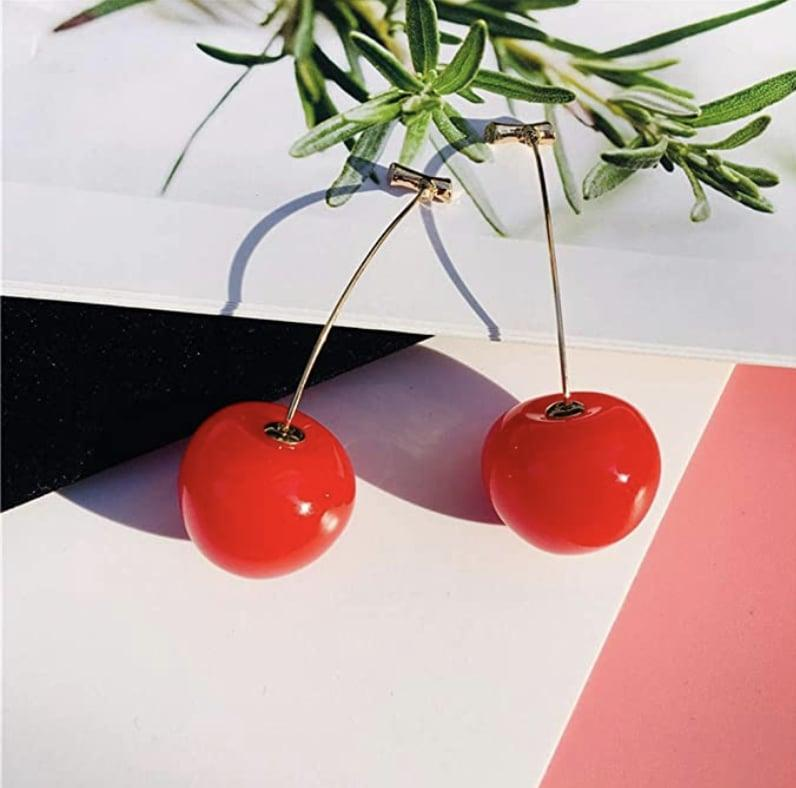 <p>Show off some personality (and your love of cherries) with these <span>Cherry Drop Earrings</span> ($8).</p>