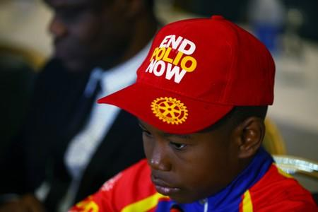 A boy wears a cap during a news conference marking the 3-year-polio-free milestone in Abuja