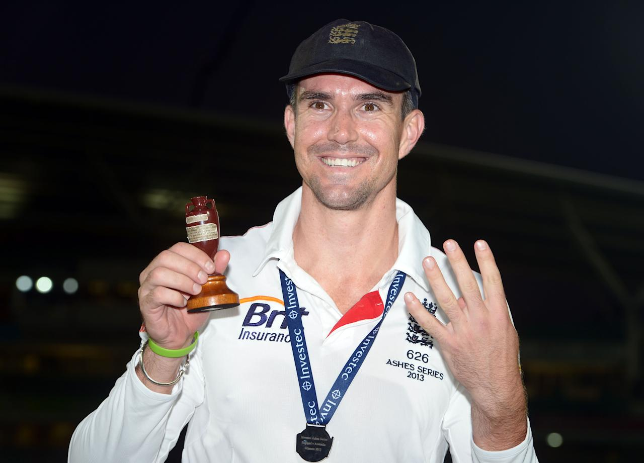 England's Kevin Pietersen with the Ashes Urn and four fingers (indicating the amount of times he has won the Ashes) on day five of the Fifth Investec Ashes Test match at The Kia Oval, London.