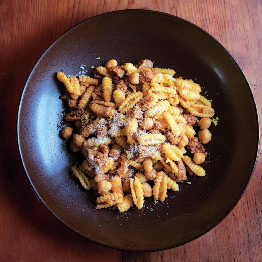 """A few flavorful ingredients, 12 ounces of good pasta, and 25 minutes in front of the stove is all you need to make this hearty weeknight supper. <a href=""""https://www.epicurious.com/recipes/food/views/pasta-with-chorizo-and-chickpeas-51187050?mbid=synd_yahoo_rss"""" rel=""""nofollow noopener"""" target=""""_blank"""" data-ylk=""""slk:See recipe."""" class=""""link rapid-noclick-resp"""">See recipe.</a>"""