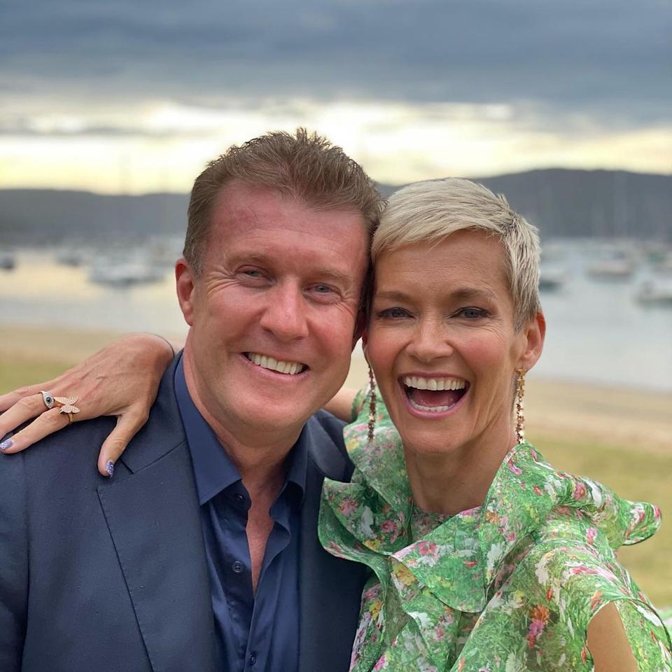 Jess Rowe with her husband, Nine News presenter Peter Overton pose for a selfie on a beach