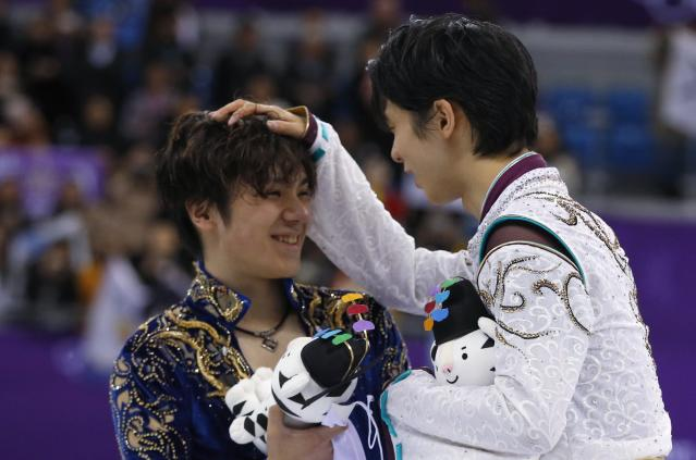 Figure Skating - Pyeongchang 2018 Winter Olympics - Men Single free skating competition final - Gangneung, South Korea - February 17, 2018 - Gold medallist Yuzuru Hanyu of Japan and silver medallist Shoma Uno of Japan celebrate. REUTERS/Phil Noble