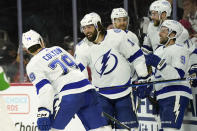 Tampa Bay Lightning left wing Pat Maroon (14) congratulates center Ross Colton (79) following Colton's goal against the Carolina Hurricanes during the third period in Game 5 of an NHL hockey Stanley Cup second-round playoff series in Raleigh, N.C., Tuesday, June 8, 2021. (AP Photo/Gerry Broome)