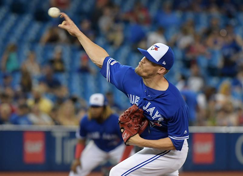 Jul 27, 2019; Toronto, Ontario, CAN; Toronto Blue Jays relief pitcher Ken Giles (51) delivers a pitch against Tampa Bay Rays in the tenth inning at Rogers Centre. Mandatory Credit: Dan Hamilton-USA TODAY Sports