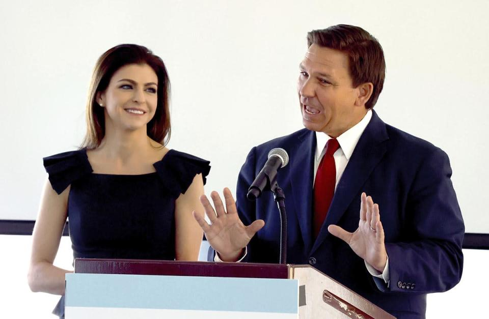 DeSantis introduces his wife Florida First Lady Casey DeSantis during a news conference announcing the Resiliency Initiative, in Orlando, Feb. 26, 2021.