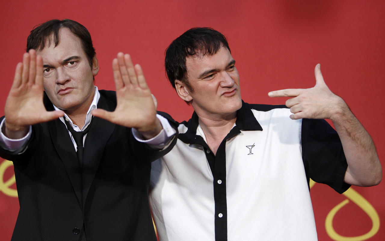 Director Quentin Tarantino (R) poses next to his wax figure after it was unveiled at Madame Tussauds in Hollywood, California August 7, 2009. REUTERS/Mario Anzuoni