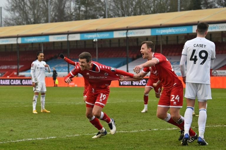 Crawley's Jordan Tunnicliffe (C) celebrates after scoring against Leeds