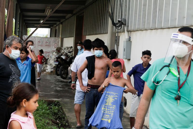 Residents stay at a shelter for people affected by the floods caused by heavy rain brought by Storm Iota, in San Pedro Sula