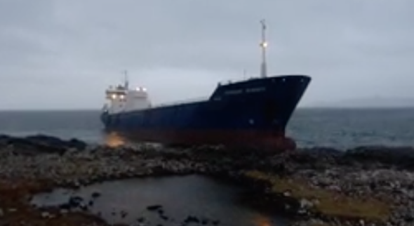 Large cargo ship hits rocks and runs aground in Scotland