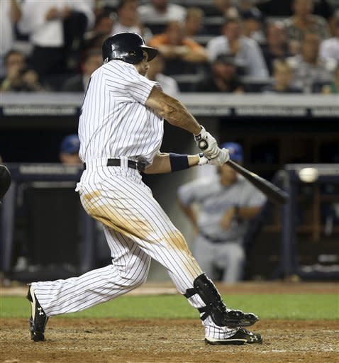 New York Yankees' Raul Ibanez hits a grand slam during the eighth inning of the baseball game against the Toronto Blue Jays Monday, July 16, 2012 at Yankee Stadium in New York. (AP Photo/Seth Wenig)