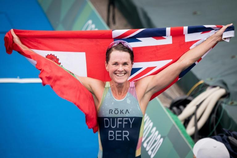 Triathlete Flora Duffy celebrates after winning Bermuda's first-ever Olympic gold
