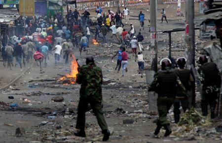 Anti riot policemen attempt to disperse protesters, supporting opposition leader Raila Odinga, in Mathare, in Nairobi