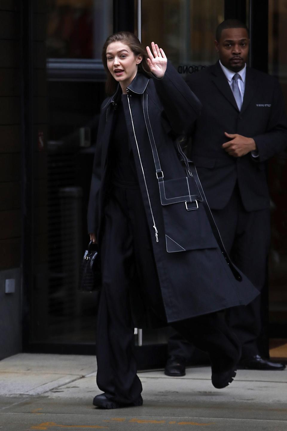 This is not your typical Gigi look but it's killer nonetheless. The model went for some combat style sneakers and a utility-style maxi coat all in black, of course. It's simple, laid back, and works!