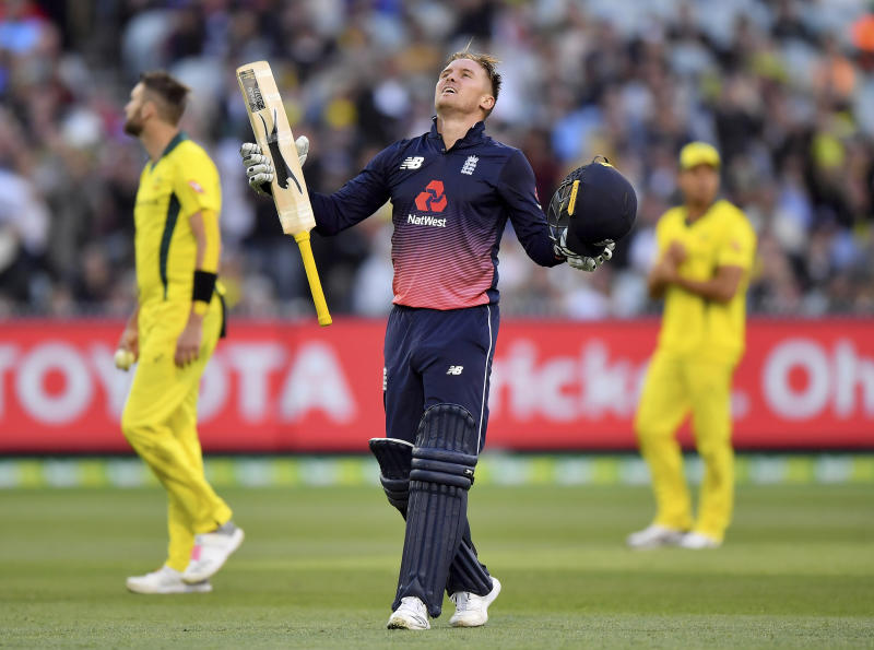 England's Jason Roy celebrates scoring a century against Australia during their ODI cricket match in Melbourne, Australia, Sunday, Jan. 14, 2018. (AP Photo/Andy Brownbill)