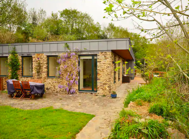 "<p>This gorgeous sustainable Cornish home, located in the depths of Liskeard, is the perfect eco getaway. With space for up to eight guests, it features modern <a href=""https://www.housebeautiful.com/uk/decorate/bedroom/a36107572/interior-design-mistakes-sleep/"" rel=""nofollow noopener"" target=""_blank"" data-ylk=""slk:interiors"" class=""link rapid-noclick-resp"">interiors</a>, a large solar PV system, heat recovery system and its own water supply, too. There's also a welcoming hot tub, so don't forget your swimsuit. Dreamy. </p><p><a class=""link rapid-noclick-resp"" href=""https://airbnb.pvxt.net/Ry5vg7"" rel=""nofollow noopener"" target=""_blank"" data-ylk=""slk:BOOK NOW"">BOOK NOW </a></p>"