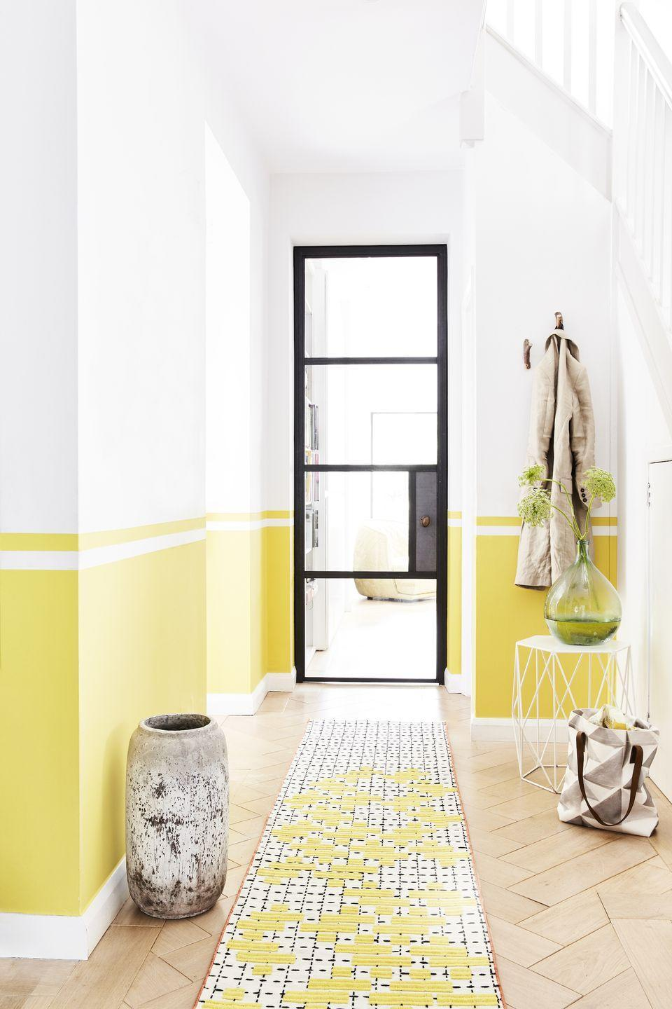 """<p>Neutrals will obviously make your space feel brighter, but don't be afraid of punchy colours. Setting the tone for the rest of the house, some of the Insta-worthy hues to dip your paintbrush into include forest greens, impactful yellow and dark navy blue. <br></p><p>'Paint is the backdrop to all <a href=""""https://www.housebeautiful.com/uk/decorate/a36517352/dated-home-decor/"""" rel=""""nofollow noopener"""" target=""""_blank"""" data-ylk=""""slk:interiors"""" class=""""link rapid-noclick-resp"""">interiors</a> and your personality can be stamped all over it,' adds David. 'Your hallway is the first point of entry. It should also give your guests an insight in to you who you are, and what your house and interior says about you.'</p><p>Walls in Ammonite estate emulsion, £49.50/2.5L, <a href=""""https://go.redirectingat.com?id=127X1599956&url=https%3A%2F%2Fwww.farrow-ball.com%2F&sref=https%3A%2F%2Fwww.housebeautiful.com%2Fuk%2Fdecorate%2Fhallway%2Fg36617179%2Finstagrammable-hallway-ideas%2F"""" rel=""""nofollow noopener"""" target=""""_blank"""" data-ylk=""""slk:Farrow & Ball"""" class=""""link rapid-noclick-resp"""">Farrow & Ball</a>; English Yellow wall paint, £41.95/2.5L, <a href=""""https://www.anniesloan.com/"""" rel=""""nofollow noopener"""" target=""""_blank"""" data-ylk=""""slk:Annie Sloan"""" class=""""link rapid-noclick-resp"""">Annie Sloan</a></p>"""