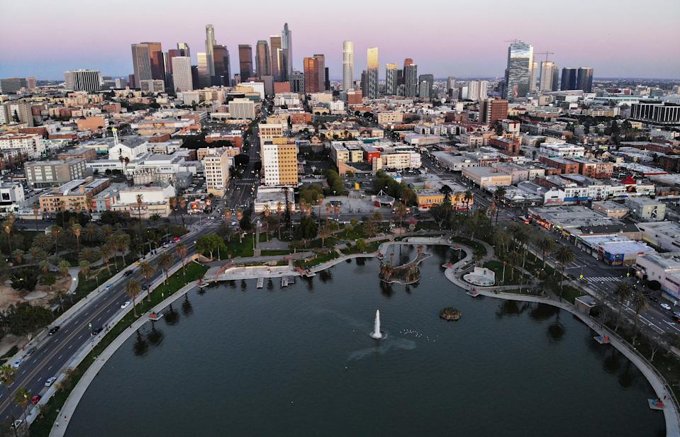 """An aerial view shows MacArthur Park and downtown in the midst of the coronavirus pandemic, on April 15, 2020 in Los Angeles, California. Environmental Protection Agency (EPA) data from March shows that Los Angeles had its longest stretch of air quality rated as """"good"""" since 1995 as Safer-at-Home orders were issued in response to the spread of COVID-19. (Photo by Mario Tama/Getty Images)"""