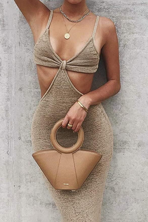"""<p>As soon as <a href=""""https://www.popsugar.com/fashion/best-summer-dresses-from-amazon-under-25-review-48377224"""" class=""""link rapid-noclick-resp"""" rel=""""nofollow noopener"""" target=""""_blank"""" data-ylk=""""slk:I saw my friend and coworker"""">I saw my friend and coworker</a> wearing this sexy <span>LouVasabuce Cutout Dress</span> ($20), I knew I had to have it too. It comes in black as well.</p>"""