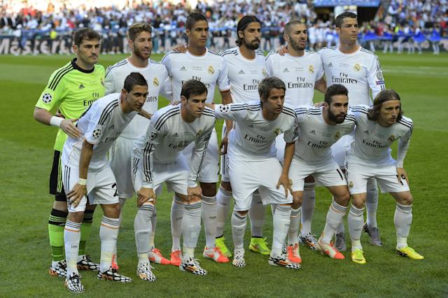 Real Madrid players pose for a photo, ahead of the start of the Champions League final soccer match between Atletico Madrid and Real Madrid, at the Luz stadium, in Lisbon, Portugal, Saturday, May 24, 2014. (AP Photo/Manu Fernandez)