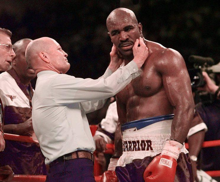 Evander Holyfield has his right ear checked by referee Mills Lane after he was bit in the ear by Mike Tyson in the third round of their WBA Heavyweight match Saturday, June 28, 1997, at the MGM Grand in Las Vegas. (AP Photo/Mark J. Terrill)
