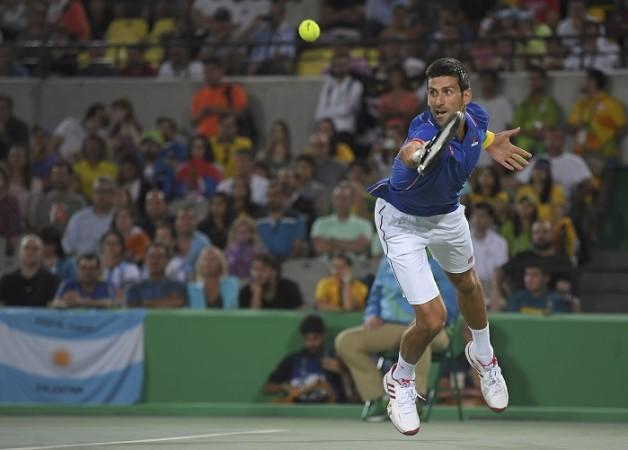 US Open: Novak Djokovic overcomes injury scare to reach second round