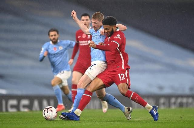 Manchester City's Kevin De Bruyne and Liverpool's Joe Gomez battle for the ball