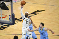 Utah Jazz guard Mike Conley (10) shoots as Memphis Grizzlies guard Grayson Allen (3) defends during the second half of Game 3 of an NBA basketball first-round playoff series Saturday, May 29, 2021, in Memphis, Tenn. (AP Photo/John Amis)
