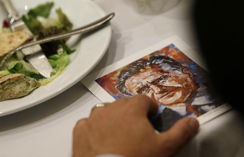 """A post card with the words """"Thank you for your support"""" and a rendition of Republican presidential candidate and former Massachusetts Gov. Mitt Romney is seen on a donor's table as Romney speaks at a campaign fundraising event in Atlanta, Wednesday, Sept. 19, 2012. (AP Photo/Charles Dharapak)"""