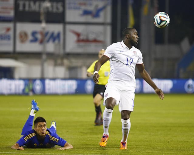 LARNACA, CYPRUS - MARCH 05: Yevhen Khachiridi (L) of Ukraine, looks on at Jozy Altidore of the USA, in action during the Ukraine v USA International Friendly at Antonis Papadopoulos stadium on March 5, 2014 in Larnaca, Cyprus. (Photo by Andrew Caballero-Reynolds/Getty Images)