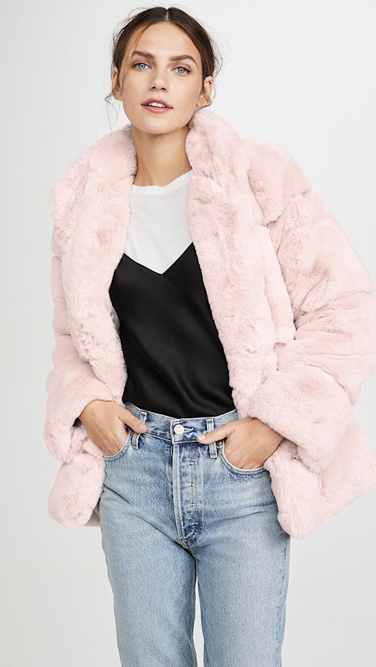 "<p>Curl up in this cute <a href=""https://www.popsugar.com/buy/Apparis-Sarah-Faux-Fur-Jacket-514911?p_name=Apparis%20Sarah%20Faux%20Fur%20Jacket&retailer=shopbop.com&pid=514911&price=290&evar1=fab%3Aus&evar9=36097844&evar98=https%3A%2F%2Fwww.popsugar.com%2Fphoto-gallery%2F36097844%2Fimage%2F46876413%2FApparis-Sarah-Faux-Fur-Jacket&list1=shopping%2Cgifts%2Ctrends%2Choliday%2Cstreet%20style%2Cwinter%2Cgift%20guide%2Cwinter%20fashion%2Choliday%20fashion%2Cfashion%20gifts%2Cgifts%20for%20women&prop13=api&pdata=1"" rel=""nofollow"" data-shoppable-link=""1"" target=""_blank"" class=""ga-track"" data-ga-category=""Related"" data-ga-label=""https://www.shopbop.com/sarah-faux-fur-jacket-apparis/vp/v=1/1531224780.htm?folderID=58606&amp;fm=other-shopbysize-viewall&amp;os=false&amp;colorId=12816"" data-ga-action=""In-Line Links"">Apparis Sarah Faux Fur Jacket</a> ($290).</p>"