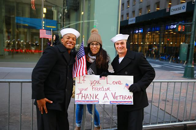 <p>Personnel from the United States Navy pose for a photo with a spectator during the Veterans Day parade in New York City on Nov. 11, 2017. (Photo: Gordon Donovan/Yahoo News) </p>