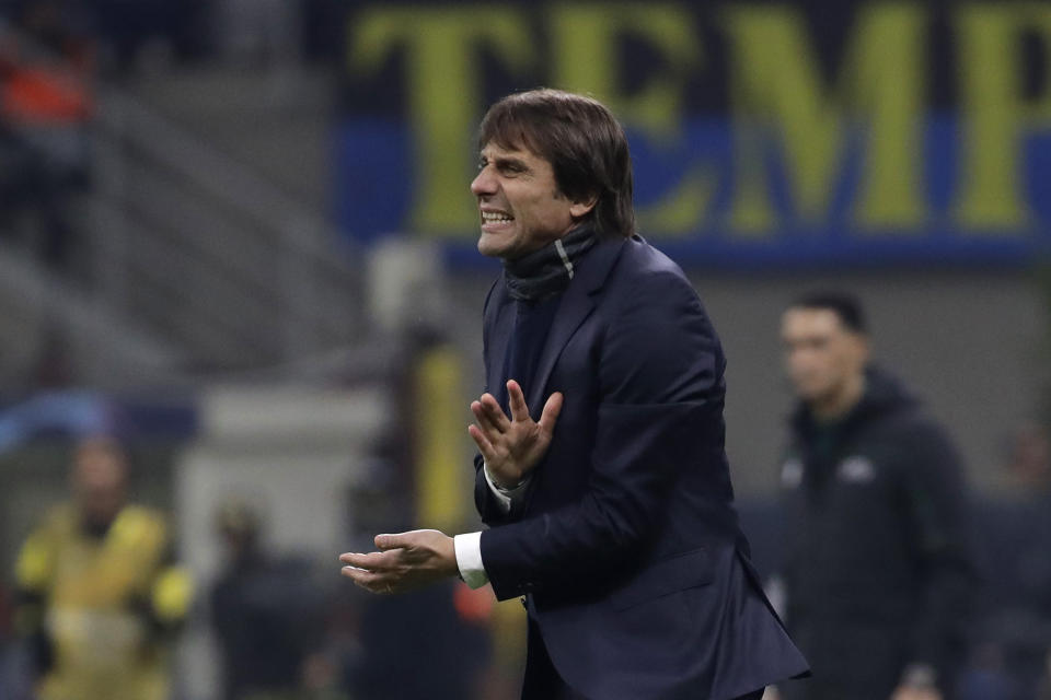 Inter Milan's head coach Antonio Conte shouts out from the touchline during the Champions League, group F soccer match between Inter Milan and F.C. Barcelona, at the San Siro stadium in Milan, Italy, Tuesday, Dec. 10, 2019. (AP Photo/Luca Bruno)