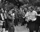 Former prime minister Pierre Trudeau and wife Margaret enjoy some music while strolling in a park in Beijing, China, on Oct. 12, 1973. THE CANADIAN PRESS/PETER BREGG