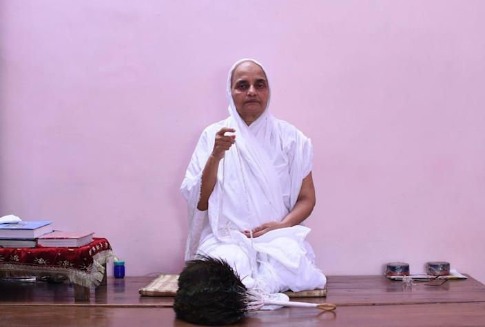A Jain nun prays in a room at the Jain Temple in the old quarters of New Delhi.