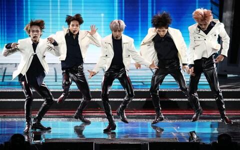 Boy band NCT DREAM perform on stage during the 9th Gaon Chart K-Pop Awards - Credit: Getty Images