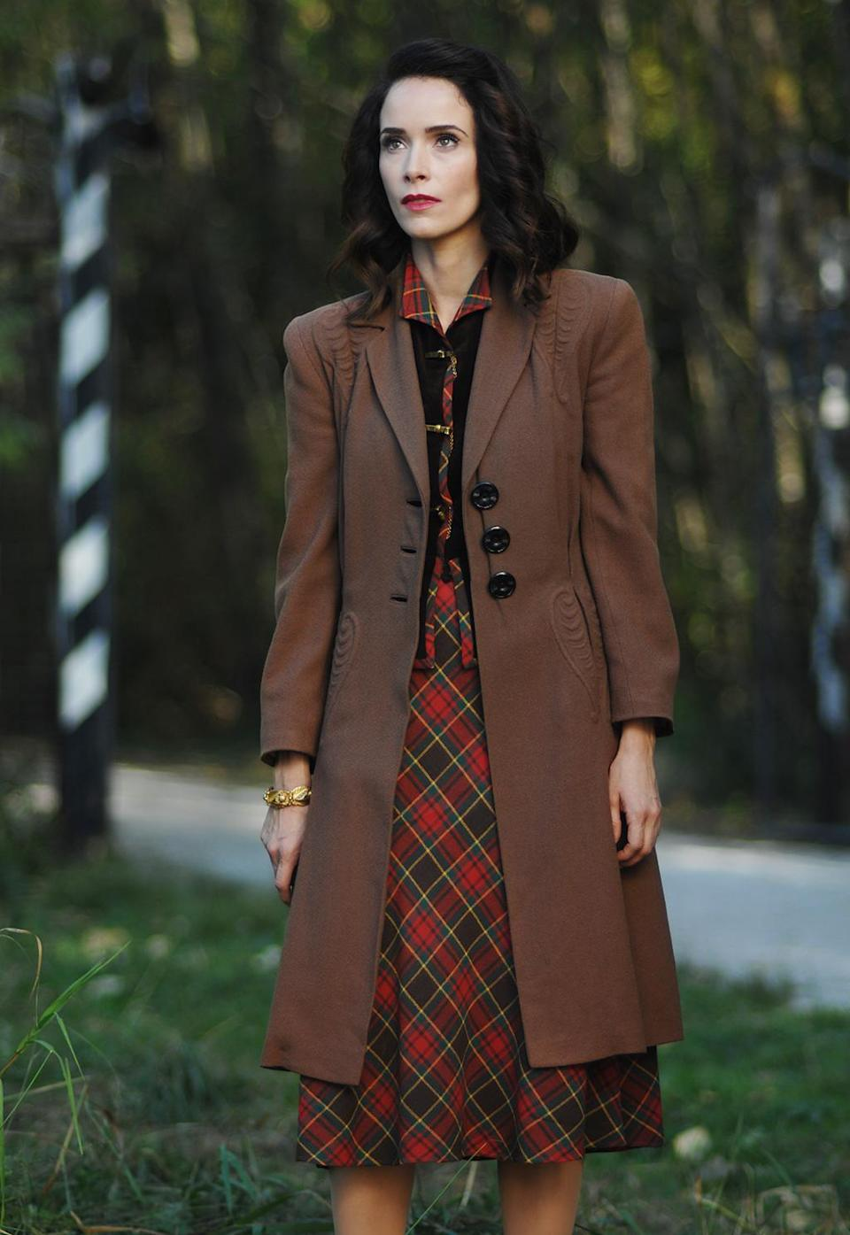 """<p>""""There wasn't a lot of color except for wealthier women in Nazi Germany. For her character, we wanted her to blend in. That palette goes with the forest. They're always hiding in that episode and sneaking up on people."""" (Photo by: Sergei Bachlakov/NBC) </p>"""