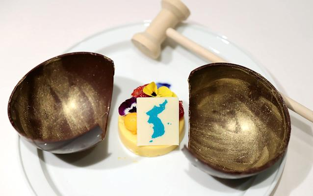 """Japan has demanded that South Korea rethink a mango mousse dessert it plans to serve at a North-South summit dinner on Friday, which features a map of the Korean peninsula - including islands disputed with Japan, a recurring irritant for Tokyo. The mousse, subtitled """"Spring of the People"""" in publicity photos of the menu released yesterday, features islands known as Takeshima in Japan and Dokdo in Korea, which lie about halfway between the East Asian neighbours in the Sea of Japan, which Seoul refers to as the East Sea. """"It is extremely regrettable,"""" a Japanese Foreign Ministry spokeswoman said on Wednesday, adding that Japan had lodged a protest. """"We have asked that the dessert not be served."""" Japan complained to South Korea about fans waving a flag with a similar design at a friendly women's ice hockey match at the Winter Paralympics between the combined North and South Korean team and Sweden in March. The new dispute comes as North Korean leader Kim Jong Un and South Korean leader President Moon Jae-in prepare to meet to discuss Pyongyang's nuclear weapons programme on Friday. What's on the menu at the Korean summit 