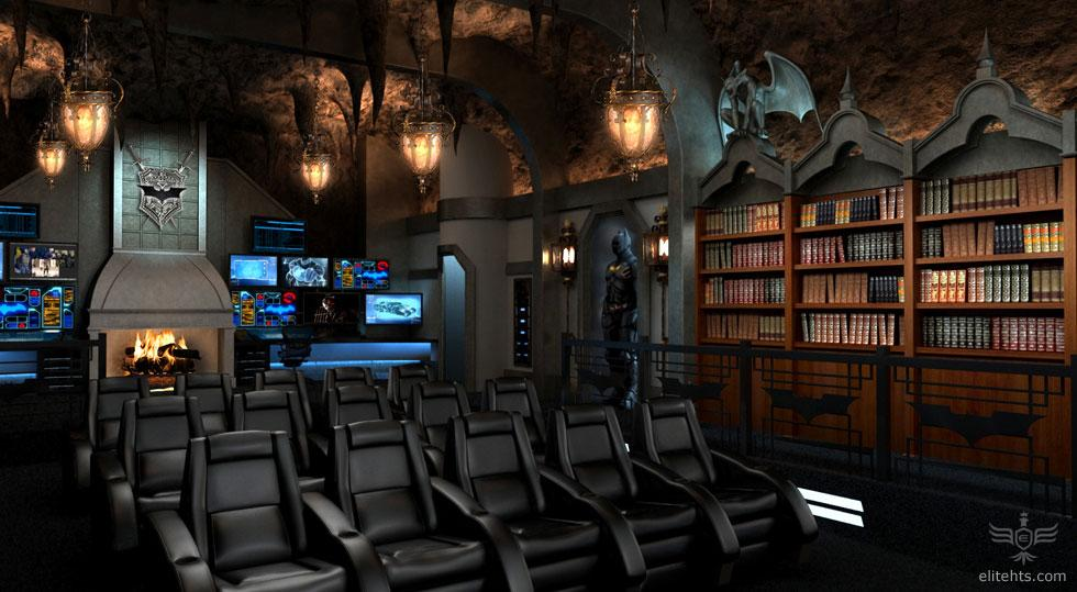 """<b>'Dark Knight' Theater</b><br><br>This rear view shot shows the home theater equipment displayed out in the open just left of the elevator, along with a """"Batcomputer."""""""