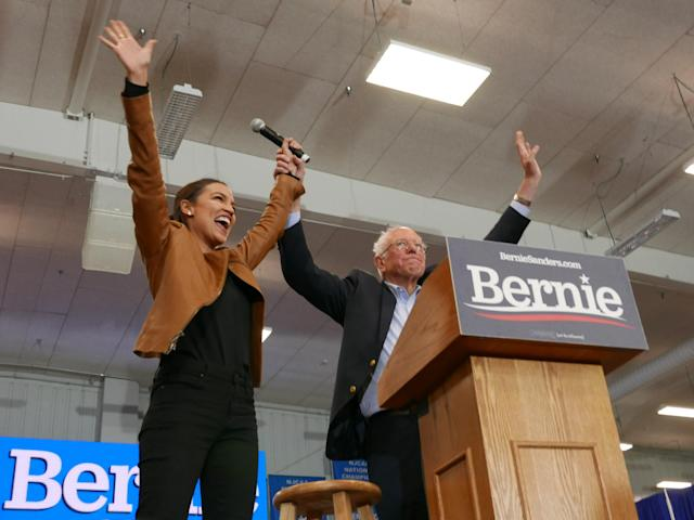 Democratic presidential candidate Sen. Bernie Sanders and Rep. Alexandria Ocasio-Cortez greet supporters on the campus of Iowa Western Community College on Nov. 8. (Photo: Hunter Walker/Yahoo News)