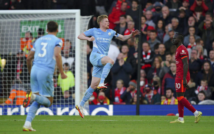 Manchester City's Kevin De Bruyne celebrates scoring his side's second goal , during the English Premier League soccer match between Liverpool and Manchester City at Anfield, Liverpool, England, Sunday Oct. 3, 2021. (Peter Byrne/PA via AP)