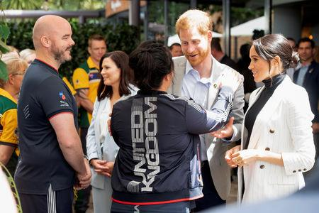Britain's Prince Harry and Meghan, the Duchess of Sussex meet Team UK competitors while attending a lunchtime Reception hosted by the Prime Minister with Invictus Games competitors, their family and friends in the city's central parkland Sydney October 21, 2018.Paul Edwards /Pool via REUTERS