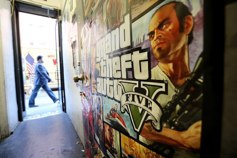 A poster promoting Grand Theft Auto V is attached to a wall at a video games shop on September 18, 2013 in New York City (AFP Photo/Mario Tama)