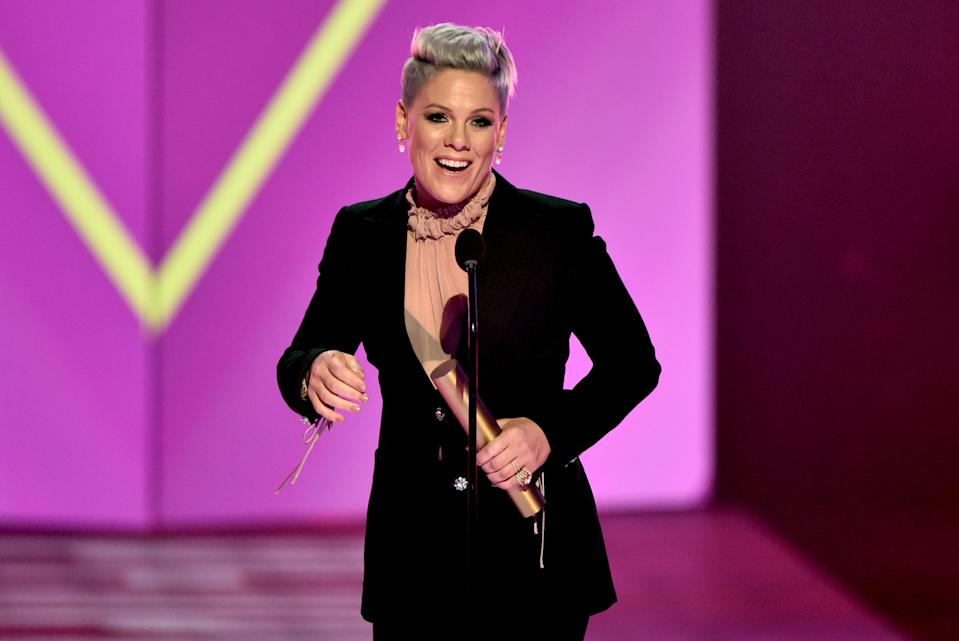 SANTA MONICA, CALIFORNIA - NOVEMBER 10: 2019 E! PEOPLE'S CHOICE AWARDS -- Pictured: Pink accepts People's Champion of 2019 award on stage during the 2019 E! People's Choice Awards held at the Barker Hangar on November 10, 2019 -- NUP_188997 (Photo by: Alberto Rodriguez/E! Entertainment/NBCU Photo Bank)